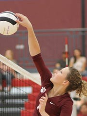 A Senior Lady Cat, Elena Williams dominated on the court at a September match against Hot Springs High.