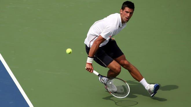 Novak Djokovic (SRB) returns a shot during his match against Philipp Kohlschreiber (GER) on day eight of the 2014 U.S. Open tennis tournament at USTA Billie Jean King National Tennis Center.