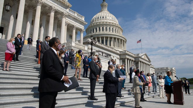 House Democrats hold a news conference on the House East Front Steps on Capitol Hill in Washington on Thursday ahead of the House vote on the George Floyd Justice in Policing Act of 2020.