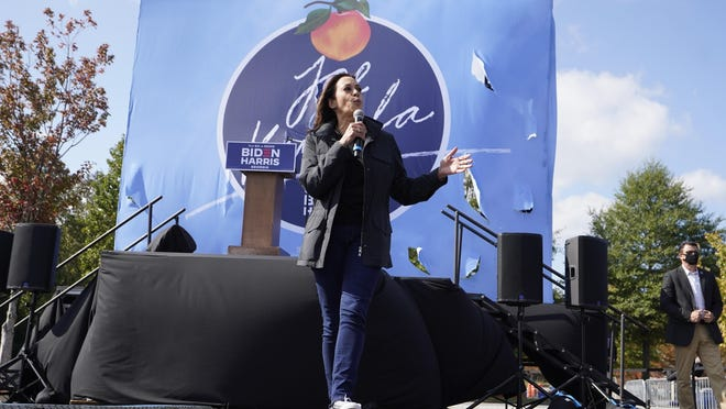 Democratic nominee for Vice President Sen.  Kamala Harris speaks during a drive in campaign rally  Sunday, Nov. 1, 2020, in Duluth, Ga.