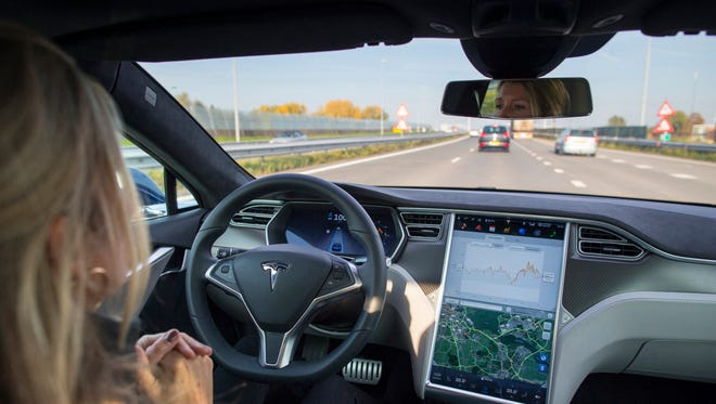 An employee drives a Tesla Motors Inc. Model S electric automobile, equipped with Autopilot hardware and software, hands-free on a highway in Amsterdam, Netherlands, on Oct. 27.