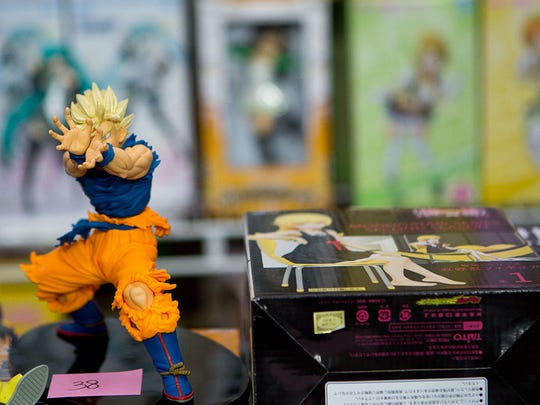 "A figurine of Goku from the anime show ""Dragon Ball Z"" sits on a vendor's table at Phoenix Comicon Fan Fest on Friday, Dec. 12, 2014, in Glendale."