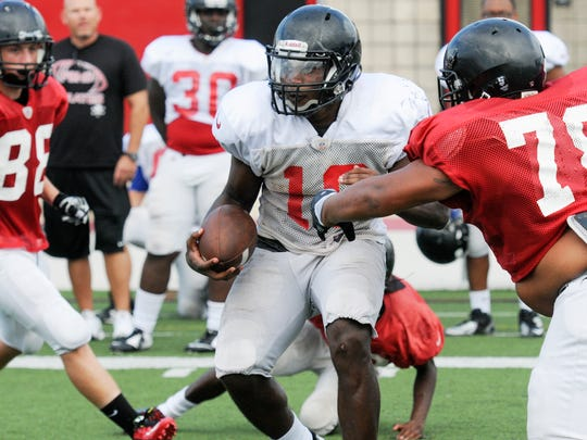 Palm Bay players run drills during practice Wednesday at Palm Bay High School.