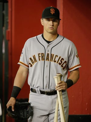 San Francisco Giants second baseman Joe Panik stands in the dugout during an April game against the Arizona Diamondbacks.