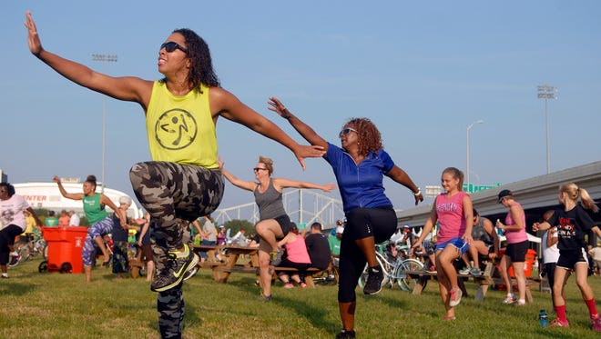 Victoria Russell, left, and Carolyn Elery, right, participate in a group Zumba session at the 11th annual Subway Fresh Fit Hike, Bike & Paddle held at Waterfront Park.  September 07, 2015