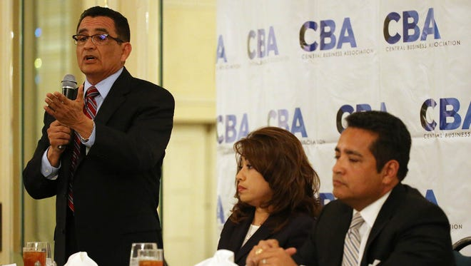 """Incumbent District Attorney Jaime Esparza answers one of the five questions that were asked of the three candidates running for district attorney. Challengers Yvonne Rosales and Leonard """"Lenny"""" Morales wait for their turns to respond to the same question. The candidates were guests of the Central Business Association at the group's monthly luncheon recently at the Camino Real Hotel in Downtown El Paso. Esparza faces Rosales in a runoff election."""