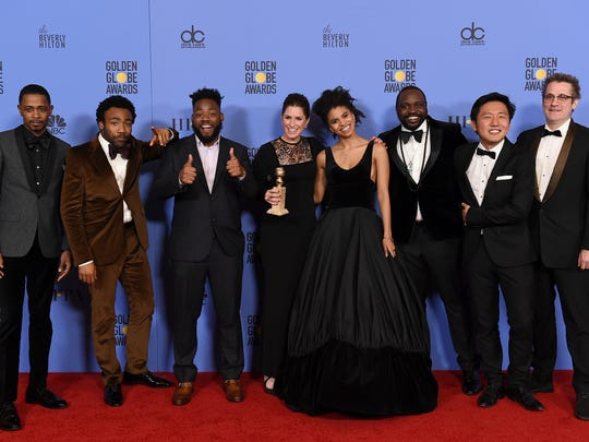 """The cast and crew of """"Atlanta"""" poses in the press room"""