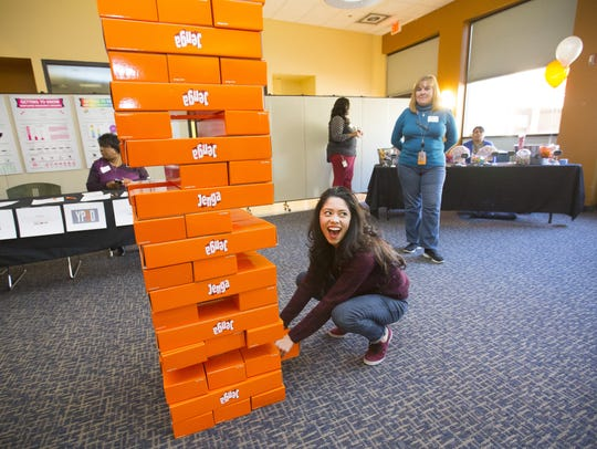 Acelia Carrillo plays a giant game of Jenga during