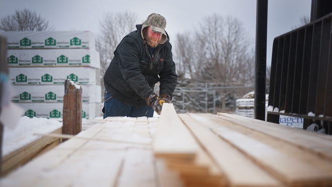 Yard technician Matt Schomaker prepares an order of lumber at Scott's Lumber & Supply Co. Tuesday, Feb. 6, in Sioux Falls. Schomaker receives orders from builders and then packages them for pick up. Lumber prices reached a record highs last week which affects pricing for homebuilders and homebuyers.