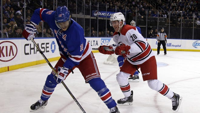 Rangers defenseman Marc Staal controls the puck as he is defended by Carolina Hurricanes center Riley Nash during the first period of Tuesday night?s game at the Garden. Nov 10, 2015; New York, NY, USA; New York Rangers defenseman Marc Staal (18) controls the puck defended by Carolina Hurricanes center Riley Nash (20) during the first period of an NHL hockey game at Madison Square Garden.