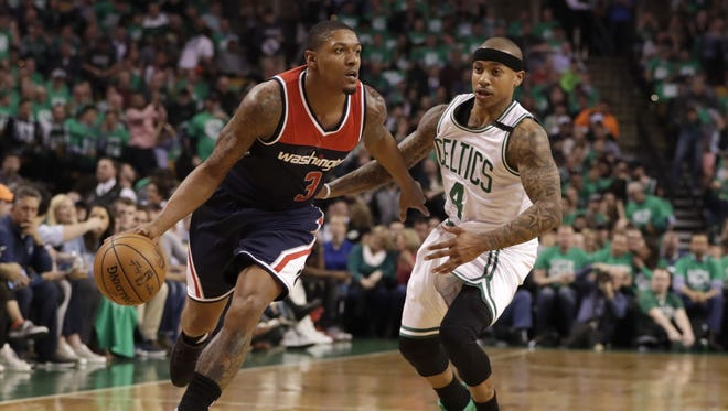 Washington Wizards guard Bradley Beal drives the ball against Boston Celtics guard Isaiah Thomas during the first quarter in Game 5 of the second round of the 2017 NBA Playoffs.