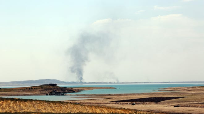 Smoke rises during airstrikes targeting Islamic State militants at the Mosul Dam outside Mosul, Iraq, on  Aug. 18, 2014.