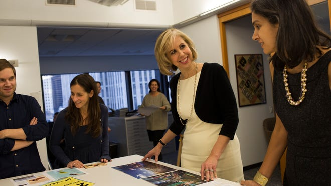 """""""Time"""" Managing Editor Nancy Gibbs,  center, reviews layouts with editorial staff in the magazine's offices in New York."""