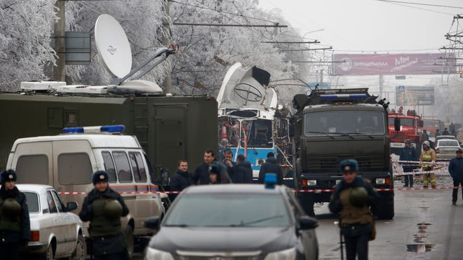Military vehicles  surround the wreckage of a trolley bus in Volgograd, Russia, on Dec. 30.