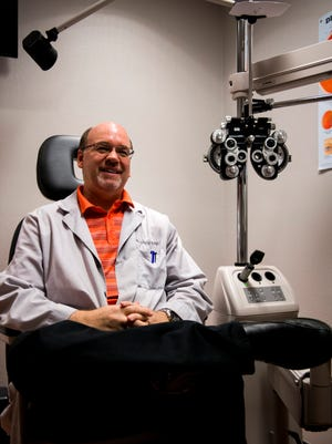 Optometrist Dr. Greg Ray poses for a portrait in a room at his office in Clarksville.