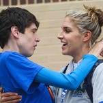 Elena Delle Donne (right) gives her sister Lizzie a kiss and hug in 2012.