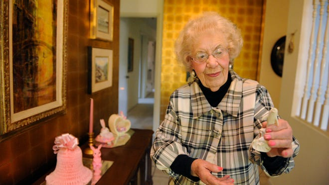 Retired educator Virginia Rocca Barton, 96, holds up a figurine she received from her beloved grand nephew, Cody Rocca, 12, of San Jose. A pink bunny at left was given to her by one of her students from the 1940s.