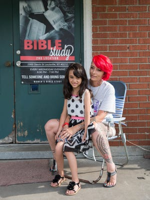 Summer Dickerson poses with one of her 11 children, Serenity Dickerson, 8, outside her Women of the Well ministry in Portland. June 21, 2017.