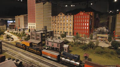 One of the train run through the mid-century city scape at EnterTRAINment Junction in West Chester where visitor where coming to stay out of the day long rain while enjoying the World's largest indoor train display.