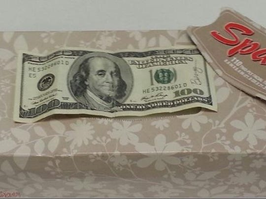 This $100 bill signed by Benny was discovered by Lisa Gettig, first-grade teacher at Wright Elementary School, in a box of tissues on May 12, 2015. She paid it forward to Willamette Valley Hospice.