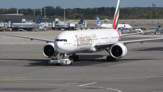 An Emirates airline Boeing 777 jet taxis at New York JFK International Airport on Oct. 18, 2012.