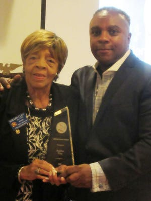 Suellen Clay is shown with TJ Coleman as she received the Aubrey Stewart Project's first ever Lifetime Service Award. Tribune photo by Ronda Wertman