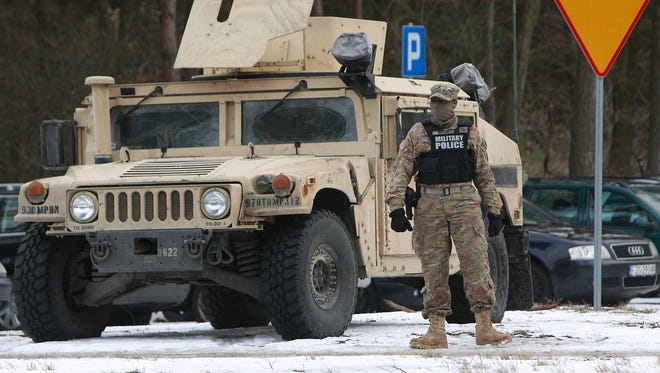 American soldier guard during an official welcome ceremony of the US troops convoy in Zagan, Poland, Jan. 12, 2017. F