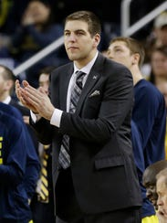 Michigan forward Mitch McGary cheers the team on from