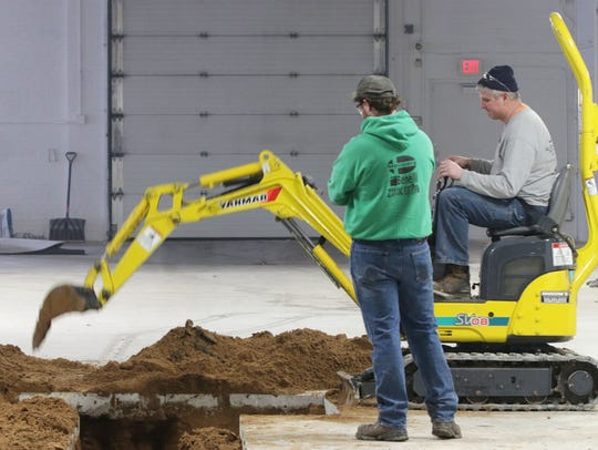 Workers help prepare the new home for Three Sheeps
