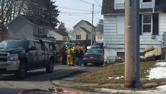 Authorities dismantle a suspected meth lab on Mechanics Street in Clyde.