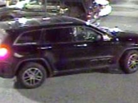 A Jeep Grand Cherokee, possibly 2011, is suspected