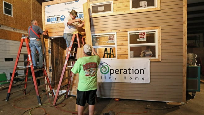 Veterans take part in a tiny house-building workshop in Racine. On Friday, Milwaukee officials signed off on a development of tiny houses for veterans on the city's northwest side.