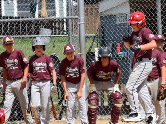 Action from the Elmira 12-under team Sunday at the Cal Ripken state tournament at Pirozzolo Park in West Elmira.