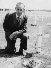 Herman Cox Sr. at the grave site of Pfc. John L. Hyatt at the Netherlands American Cemetery in Margraten.