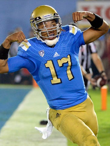 UCLA quarterback Brett Hundley (17) scores on a second-half