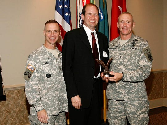Mike Reese is shown receiving Fort Polk's Morale, Welfare, and Recreation award in 2009 on behalf of American Moving and Storage for support to soldier MWR programs. Flanking Reese were (from left) Gen. James C. Yarbrough and Command Sgt. Major Christopher Greca.