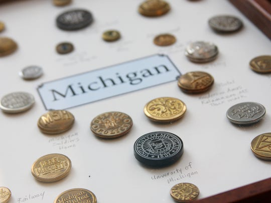 One of the displays at the Governor's Mansion in Marshall starting this weekend showcases Michigan buttons.