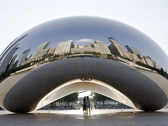 The Cloud Gate sculpture in Millennium Park reflects the Chicago skyline.