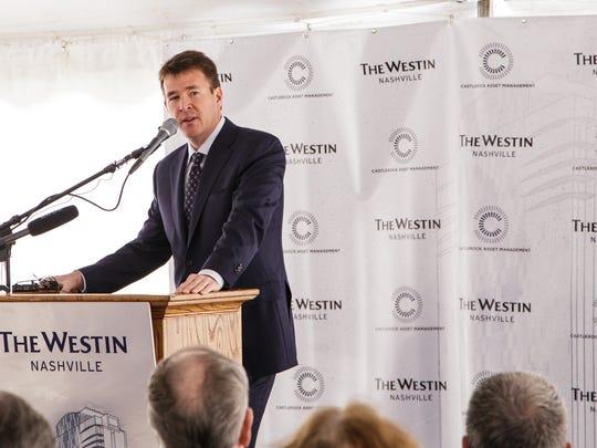 Kevin Fee, co-managing partner for CastleRock Asset Management, speaks at Wednesday's groundbreaking ceremony.