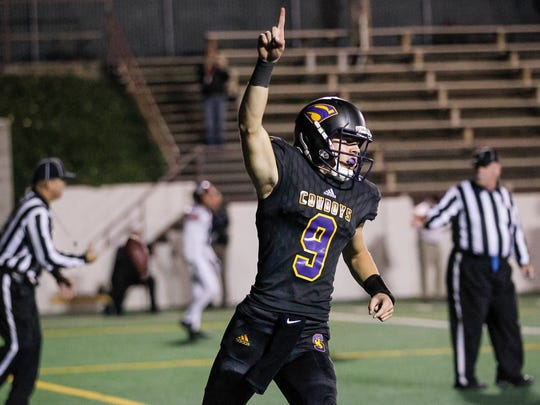 Salinas' Brett Reade celebrates after scoring on a quarterback keeper during a Central Coast Section: Open Division I semi-finals playoff football game between the Salinas Cowboys and the Los Gatos Wildcats at the Pit at Salinas High School on Friday, November 24, 2017 in Salinas, Calif. Vernon McKnight/for The Californian