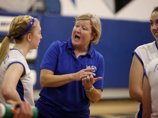 Fort Defiance coach Sue Leonard talks with the players during a time-out at their match against Broadway on Wednesday, Sept. 30, 2015 at Fort Defiance.