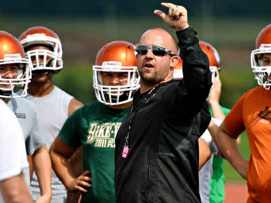 Central York head football coach Josh Oswalt leads his players during a recent workout. The Panthers are ranked No. 12 among central Pennsylvania high school teams, regardless of class size.