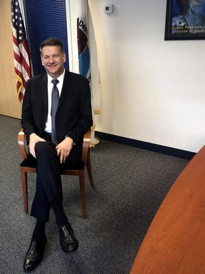 Fall RIver native Timothy Shea, who in May was appointed as Acting Administrator of the U.S. Drug Enforcement Administration, is seen here in the DEA's New Bedford regional office.  Herald News photo by Charles Winokoor