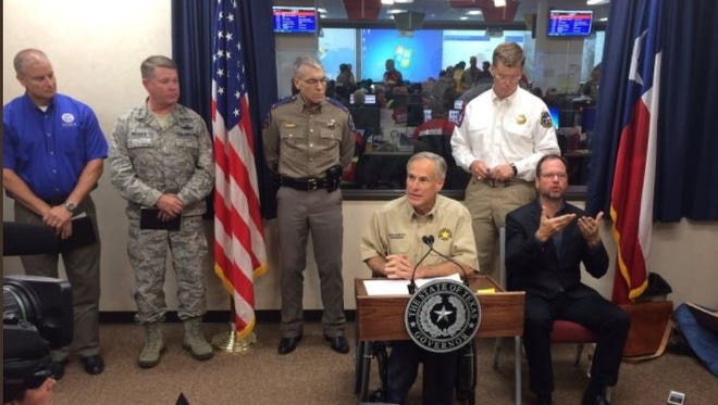 Texas Gov. Greg Abbott makes his second appearance at the state's Hurricane Harvey response nerve center on Aug. 26, 2017.