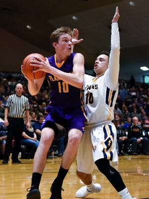 Flandreau guard Dylan Lebrun (10) drives down the baseline during their high school basketball game at the Corn Palace for the Hanson Classic on Saturday, Jan. 20, 2018. Flandreau beat Tea Area 68-67.