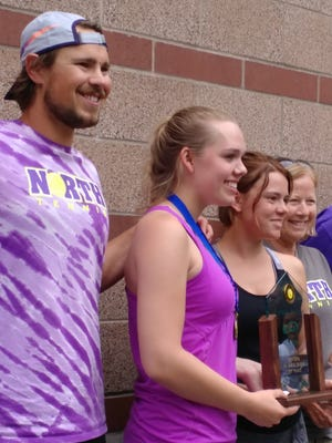 North Kitsap's girls tennis team — (from left) head coach Jordan Prince, Danya Wallis, Anna Bronchal, assistant Lynne Prince and assistant Steve Frease poses with the Class 2A state team trophy Saturday at the Nordstrom Tennis Center in Seattle.