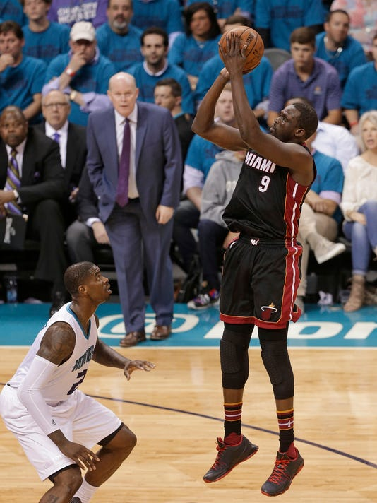 Miami Heat's Luol Deng (9) shoots over Charlotte Hornets' Marvin Williams (2) during the second half in Game 6 of an NBA basketball playoffs first-round series in Charlotte, N.C., Friday, April 29, 2016. The Heat won 97-90. (AP Photo/Chuck Burton)