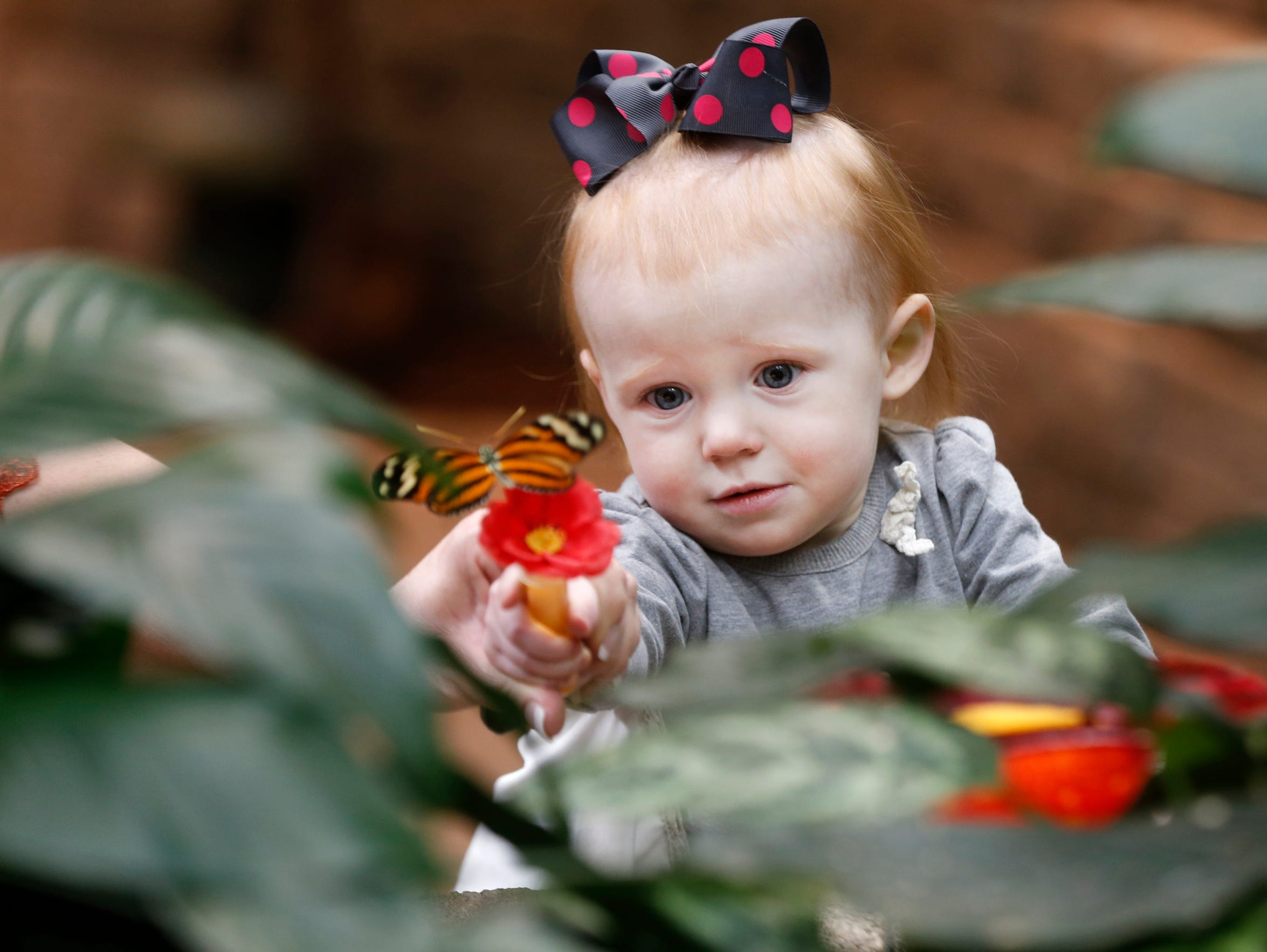 Ella June Kozak, 1, of Oklahoma City, uses a vile of