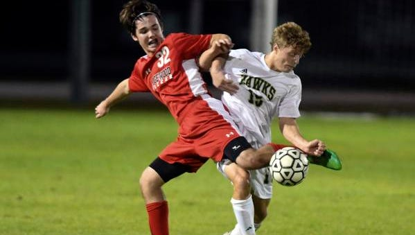 Grant Paparella of Edgewood and John Dashi of Viera get tangled up during Thursday's game.