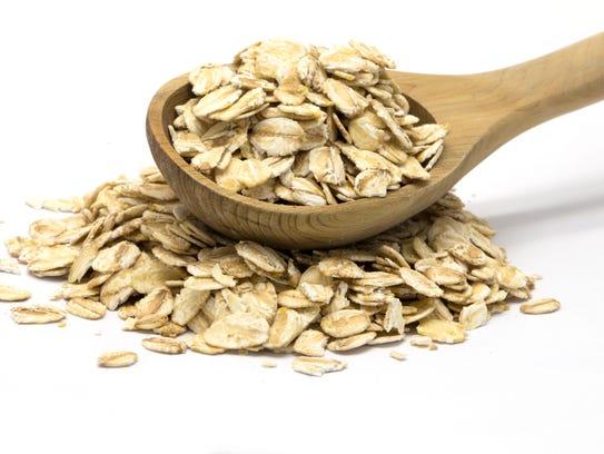 Oats in wooden spoon